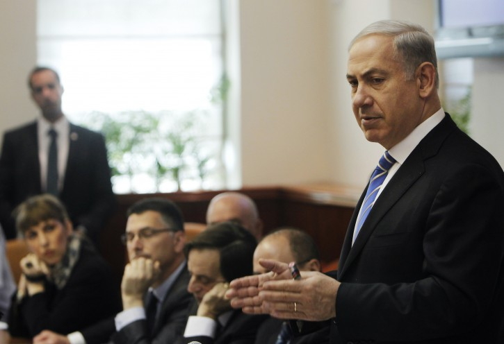 Israel's Prime Minister Benjamin Netanyahu, right, speaks during the weekly cabinet meeting in Jerusalem, Sunday, Jan. 1, 2012. (AP Photo/Ronen Zvulun, Pool)