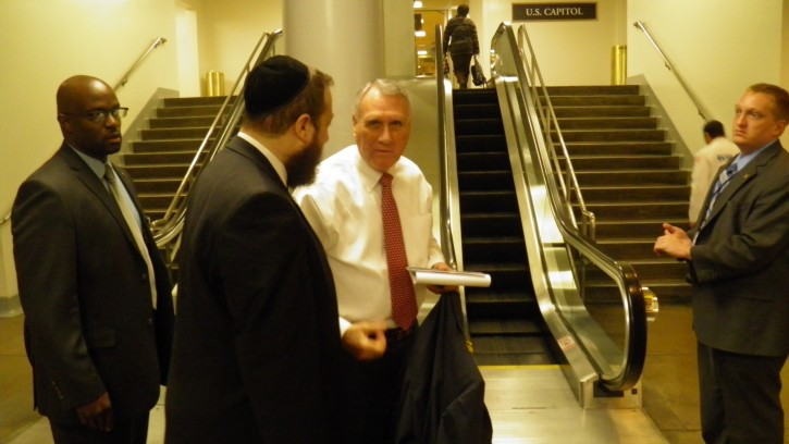 Ezra Friedlander greets Senator Jon Kyl who serves as Republican Whip, the second highest position in Senate Republican leadership as he gets off the US Capitol subway (underground) on the way to the Capitol.