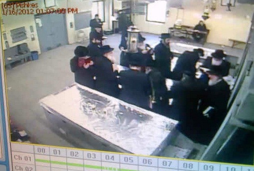 Surveillance video at the Kever of Satmar Rabbis shows Belz Chasidim praying at the tombstones on Jan 16 2012