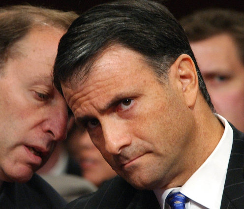 FILE - In this Sept. 29, 2004, file photo Jack lobbyist Abramoff is advised by his attorney Abbe Lowell, left, as he refuses to answer questions before the Senate Indian Affairs Committee on Capitol Hill.  AP