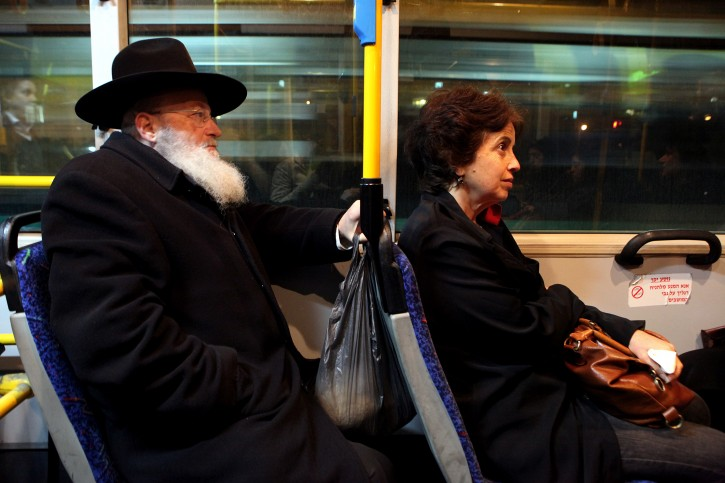 Israeli women protesting against a gender-segregation campaign by ultra-Orthodox Jews sit at the front of a bus in defiance of demands by hardliners that women sit at the back, in Jerusalem on 01 January, 2012. Reports state that hundreds of mostly secular activists boarded buses used mostly by ultra-Orthodox Jews near Tel Aviv and in Jerusalem to voice opposition against the practice of separation between women and men on a number of lines traveling through religious neighbourhoods.  EPA/ABIR SULTAN