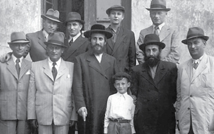 Nitra, 1946, trying to rebuild out of the ashes. Behind Rav Landau (C) is his only surviving son, Aron Tzvi (wearing a cap) — who found his family after years on the run