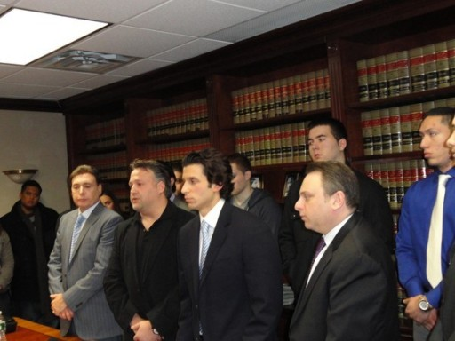 William Cataldo, center left, in black, with attorneys and other former employees of Morrell Caterers. Credit StephenJ.Bronner