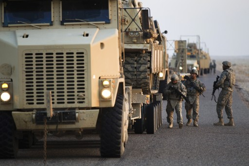 FILE - oldiers with the 3rd Brigade Combat Team, 1st Cavalry Division perform a security check on their vehicles near the Kuwaiti border as part of the last U.S. military convoy to leave Iraq, 18 December 2011.  EPA