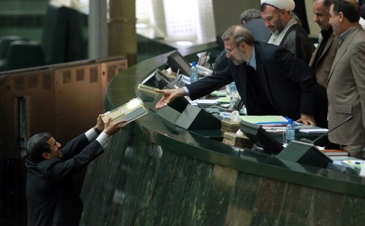 FILE -  Iranian president Mahmoud Ahmadinejad (L) delivers budget papers to Iranian parliament speaker Ali Larijani (R) at the Iranian parliament in Tehran, Iran, 01 February 2012.  EPA