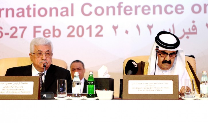 Qatar's Emir Sheikh Hamad bin Khalifa al-Thani (R) and Palestinian President Mahmoud Abbas (L) attend the opening session of the International Conference for the Defense of Jerusalem in Doha, Qatar, 26 February 2012. The conference lasts three days and gathers about 350 Arab, Muslim and other countries representatives. According to local media reports, Emir of Qatar said that Jerusalem's Arab identity is threatened and called for UN investigation into Israeli settlements and expansion in and around districts of Jerusalem mostly inhabited by Arabs. The remarks come amid latest clashes in Jerusalem.  EPA/STR