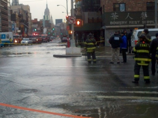 Water flowed into Delancey Street and the Bowery after a main broke on Feb. 14, 2012. PHOTO CREDIT DNAinfo/Trevor Kapp