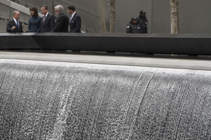 British Prime Minister David Cameron, center, and his wife Samantha, second from left, take in the sight of the Reflecting Pool during a tour of the National September 11 Memorial with New York City Mayor Michael Bloomberg, left, and Port Authority of NY and NJ Executive Director Patrick J. Foye, second from right, and Deputy Executive Director Bill Baroni, Thursday, March 15, 2012 in New York.  (AP Photo/Mary Altaffer, Pool)