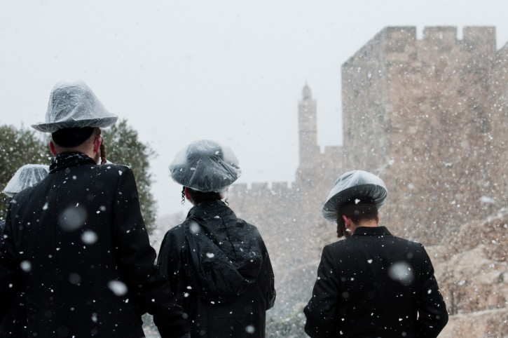 Ultra orthodox Jewish boys seen near the Tower of David near Jerusalem's Old City, on a snowy winter day in Jerusalem. March 02, 2012. Photo by FLASH90