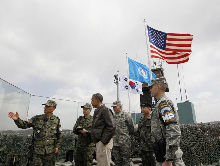 President Barack Obama meets with both South Korean and US members of the Military at Observation Post Ouellette in the Demilitarized Zone, the tense military border between the two Koreas, in Panmunjom, South Korea, Sunday, March 25, 2012. (AP Photo/Pablo Martinez Monsivais)