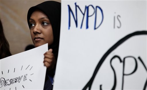 Fatima Kutty of Long Island, N.Y., a New York University senior, gathered with other students, faculty and clergy on the NYU campus Wednesday, Feb. 29, 2012 to discuss the recent discovery of surveillance by the New York Police Department on Muslim communities. (AP Photo/Craig Ruttle)