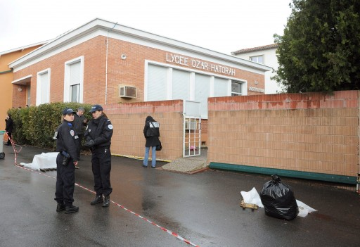 A Police officer are seen outside the Ozar Hatorah Jewish school, in Toulouse, France, 19 March 2012, where a man opened fire in front of the school and killed a 30-years old teacher and three children aged 6, 3 and 10. Two others were wounded  EPA/CAROLINE BLUMBERG