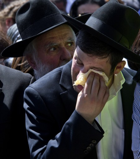 Ultra-Orthodox Jews at the funeral of four Israelis in a Jerusalem cemetery, 21 March 2012. The four, a Rabbi and his two young sons and a young girl were all of French Jewish descent and were killed together in the shooting attack at the Jewish school in Toulouse, France on 19 March 2012.  EPA/JIM HOLLANDER