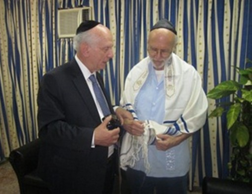 In htis file photo: Rabbi Arthur Schneier meets with American serving fifteen years in Cuban prison and makes an interfaith humanitarian appeal to government for the release of Alan Gross, The Rabbi visited with Gross on the eve of Purim, at a Military hospital for an hour and a half and presented him with a tallit (prayer shawl), tefillin (phylacteries), the biblical Book of Esther, and hamantaschen (holiday pastries).