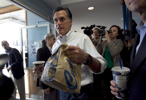 Republican presidential candidate, former Massachusetts Gov. Mitt Romney, center, gets lunch at a Culver's restaurant in Johnson Creek, Wis., Sunday, April 1, 2012. (AP Photo/Steven Senne)