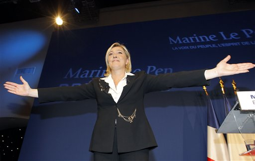 French far-right leader and National Front Party candidate for the presidential elections Marine Le Pen reacts after the first round of presidential elections, Paris, Sunday, April 22, 2012. (AP Photo/Jacques Brinon)
