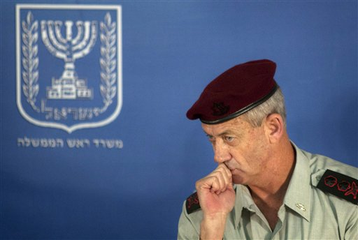 FILE - In this Feb. 14, 2011 file photo, Israeli Chief of Staff Lt. Gen. Benny Gantz looks on during a change of the epaulets ceremony in the Prime Minister's office in Jerusalem. Israel's military chief has hinted that other countries could also strike Iran's nuclear sites to keep the country from acquiring atomic weapons. (AP Photo/Sebastian Scheiner, File)