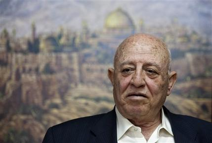 Former Palestinian Prime Minister Ahmed Qureia looks on during an interview with the Associated Press in his office in Abu Dis, near Jerusalem, Monday, April 23, 2012. With gloom deepening over the prospects for peace, Qureia a leading Palestinian figure is suggesting the Palestinians might drop the