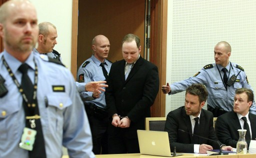 FILE - The accused Anders Behring Breivik (R) arrives at the court for his hearing in Oslo, Norway, 06 February 2012.