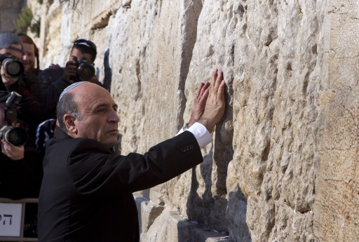 Shaul Mofaz, the newly elected leader of the centrist Israeli party Kadima (Forward), places his hands on the Western Wall as he visits the holy site in Jerusalem, 28 March 2012. EPA