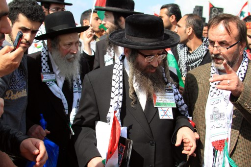 American Rabbi Yisrael Dovid Weiss (C), and other members of Neutrei Karta (Orthodox Jews United against Zionism) with Palestinian activists at Beaufort castle in Arnun, Lebanon, 30 March 2012, during a ceremony to mark the annual 'Land Day. Palestinians clashed with Israeli soldiers and police in the West Bank and East Jerusalem on Friday, and one person was reported killed, during protests to mark Land Day, an annual commemoration of the 1976 shooting of six Arab-Israelis.  EPA/HASSAN BAHSOUN