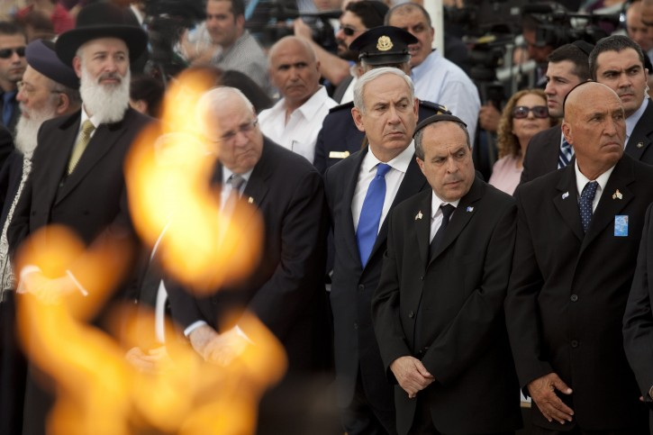 Israeli Prime Minister Benjamin Netanyahu (C) attends a state memorial ceremony on Remembrance Day for the fallen soldiers of Israel's wars, in Yad Lebanim soldiers Memorial in Jerusalem, Israel, 24 April 2012.  EPA/ABIR SULTAN/POOL