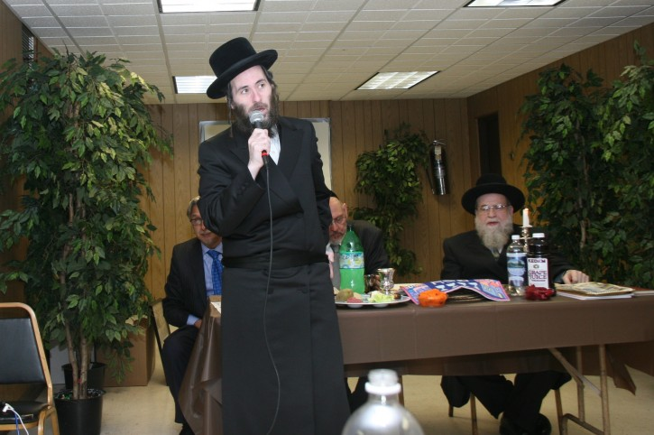 Mordechai Jungreis speaks during a model Seder in April for victims of sexual abuse and their advocates in the ultra-Orthodox community. Facing the camera from left is Mark Appel, director of Voice of Justice, a victims' rights group; Rabbi Yosef Blau, the spiritual adviser at Yeshiva University; and Rabbi Gershon Tannenbaum, the spiritual leader of B'nai Israel of Linden Heights. Photo: Shimon Gifter