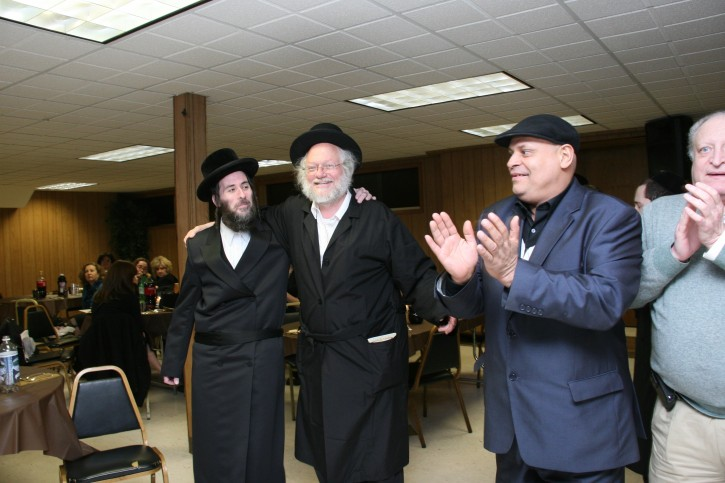 Mr. Jungreis Dancing with Rabbi Nuchem Rosenberg of Williamsburg, during a model Seder in April for victims of sexual abuse and their advocates in the ultra-Orthodox community. Rosenberg runs a low-tech telephone call-in line on which he records impassioned lectures accusing rabbis of covering up child sexual abuse cases and urges victims to call 911. He was formally ostracized by a group of prominent rabbis in 2008.