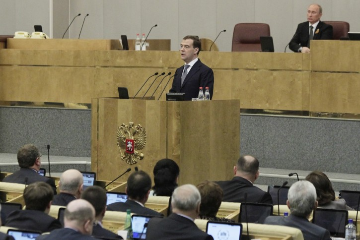 Former Russian President Dmitry Medvedev addresses the State Duma (lower house of parliament) with a program speech as he is introduced by his successor Vladimir Putin (background) as a candidate for Prime Minister in Moscow, Russia, 08 May 2012.  EPA/YURI KOCHETKOV
