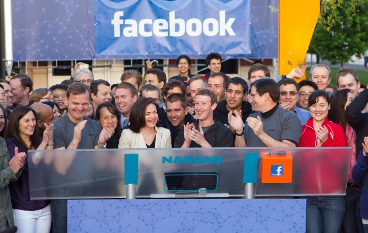 A handout photograph made available by Facebook showing Facebook Founder, Chairman and CEO Mark Zuckerberg (C) applauding after ringing the Nasdaq's opening bell from the Facebook Headquarters from Menlo Park, California, USA 18 May 2012. Facebook offers its Initial Public Offering.  EPA/ZEF NIKOLLA / FACEBOOK /HANDOUT