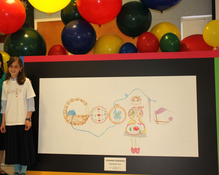 Eleven year old Johanna Robinson (L) of Brookville stands next to her Google design