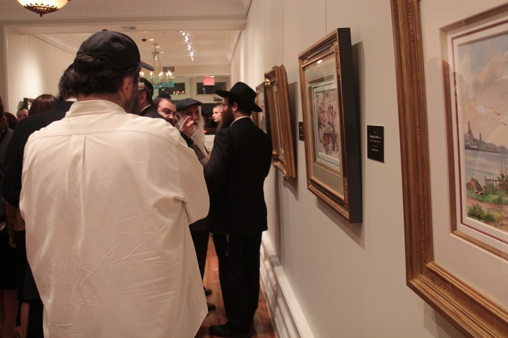 Hundreds turned out for The Betzalel Gallery's grand opening and inaugural Art exhibition displaying the work of Artist Itshak Holtz. (Photo Credit: Shmuel Lenchevsky)