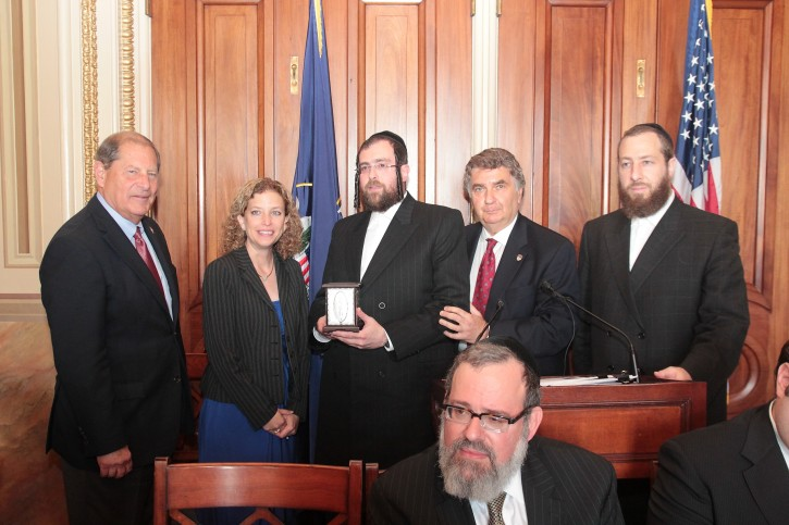 "L-R Representative Robert L. ""Bob"" Turner (R-NY); Representative Debbie Wasserman Schultz (D-FL) - Chair of the Democratic National Committee; Rabbi Abe Friedman - Community Liaison to the New York State Senate on Homeland Security; Rabbi Joseph Potasnik, executive vice president of the New York Board of Rabbis; Ezra Friedlander – CEO The Friedlander Group"