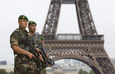 FILE - French soldiers patrol near the Eiffel Tower