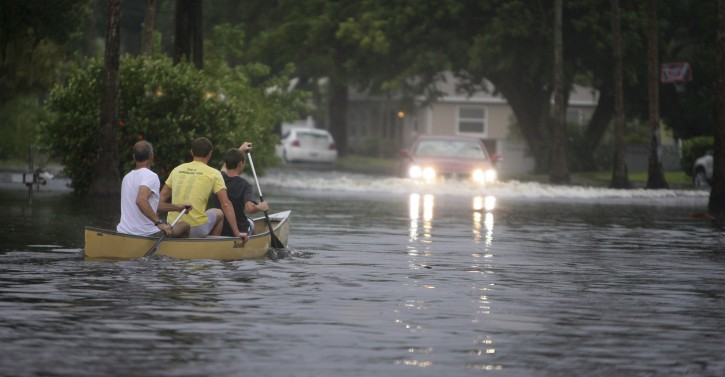 Canoe-goers navigate flooded streets as flooding continues to worsen and Tropical Storm Debby pounds the Tampa Bay, Fla., area Sunday, June 24, 2012. Tropical Storm Debby continued to churn in the Gulf of Mexico. (AP Photo/Tampa Bay Tribune, Chris Zuppa)