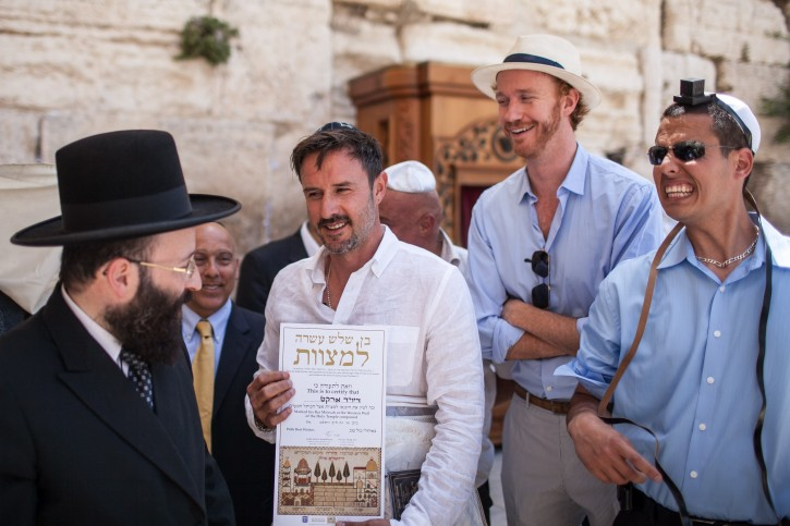 """Movie star David Arquette prays at the Western Wall on Monday June 11 2012. Arquette, who arrived in Tel Aviv over the weekend, is filming an episode of the travel show """"Trippin'"""" in Israel, and decided to mark his trip to Israel with a bar mitzva at the Kotel at the at the age of 41, only 28 years late. He was raised on a Virginia religious commune his parents co-founded that embraced aspects of Hinduism, Buddhism and Islam. His mother was raised an observant Jew, although she eschewed her religious roots, and his father was a convert to Islam. PHoto by Noam Moskowitz/Flash90"""