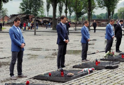 In this photo provided by the German Soccer Federation, DFB, Miroslav Klose, manager Oliver Bierhoff, captain Philipp Lahm and Lukas Podolski, from left, place candles during a visit of the German national soccer team at the Nazi death camp of Auschwitz in Oswiecim, southern Poland, Friday, June 1, 2012. Photo: DFB, Markus Gilliar / AP