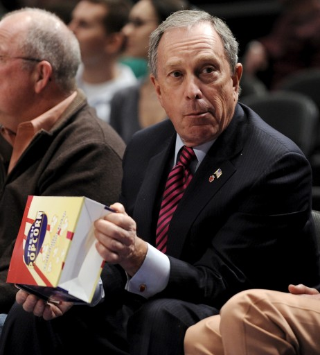File photo of Mayor Michael Bloomberg eats popcorn at Madison Square Garden. EPA/JUSTIN LANE