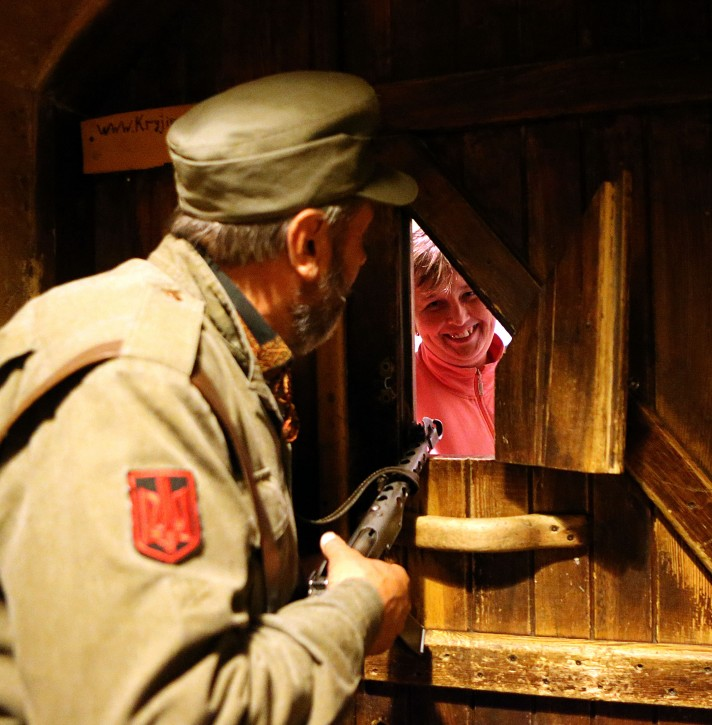 A door guard dressed dressed as a WW II Ukrainian Partizan - known as Ukrainian Insurgent Army (UPA) -  checks who wants to enter into the theme pub and restaurant 'Kryjivka' near Rynok Square in Liviv, Ukraine 06 June 2012. Enjoying increasing popularity among visitors over the years, the place is dedicated to the memory of the UPA struggle and sacrifies against Nazi Germany and decorated with grenades, rifles and other military antiques.  EPA/ANTONIO BAT