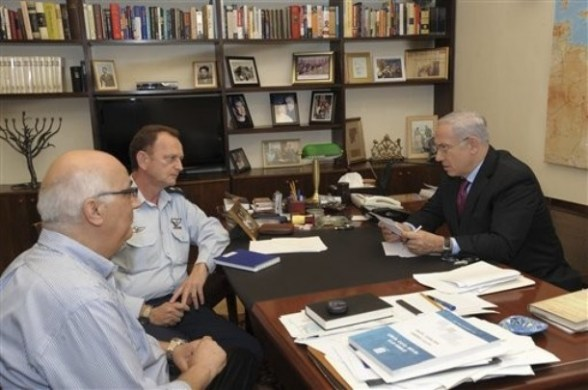 In this file photo released by the Israeli Government Press Office, Israeli Prime Minister Benjamin Netanyahu, right, meets with his military adviser Major General Yohanan Locker, center, and with David Meidan, a coordinator for negotiations over the release of Israeli captured soldier Gilad Schalit, left, in netanyahu's office in Jerusalem, Sunday, Oct. 16, 2011.