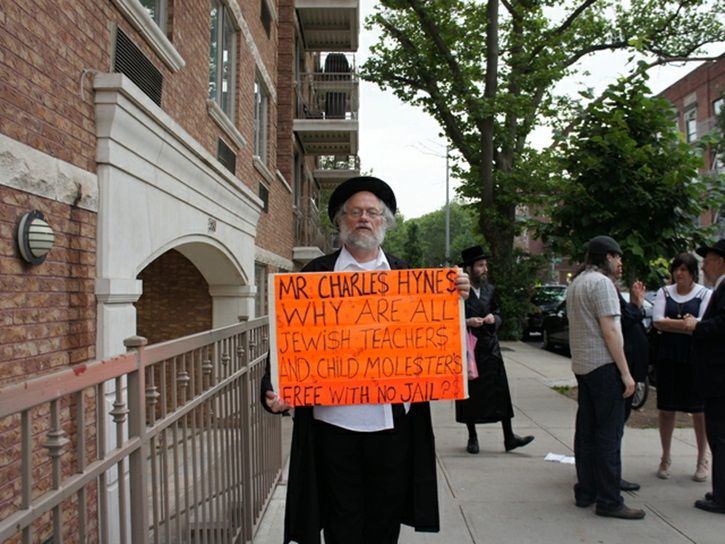 Rabbi Nuchem Rosenberg protest outside Crown Heights Ohel Nosson Shul on Sunday, June 10, 2012 holds a sign decrying Kings County District Attorney Charles Hynes for his controversial policy of withholding the names of accused and convicted pedophiles from Orthodox Jewish communities across Brooklyn. (DNAinfo/Sonja Sharp)