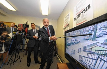 In this file photo Assemblyman Dov Hikind shows video that indicates trumped-up city Sanitation Department summonses.