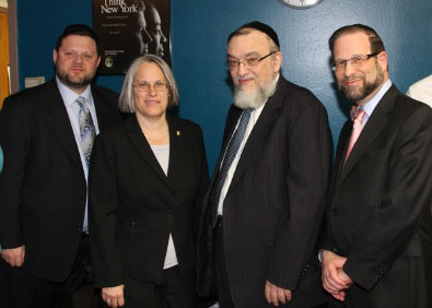 Assemblywoman Helene Weinstein with representatives from Agudath Israel of America. Pictured with the Assemblywoman are Rabbi Shmuel Lefkowitz, Vice President for Intergovernmental and Community for Agudah, and Chaskel Bennett and Leon Goldenberg, both members of the board of trustees, and community leaders.