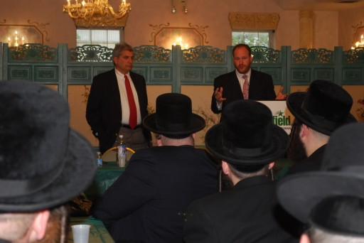 """Councilman David G. Greenfield announces the """"I'm a Yeshiva Parent and I Vote!"""" effort with Councilman Domenic Recchia at a meeting with dozens of yeshiva administrators in Borough Park this week."""