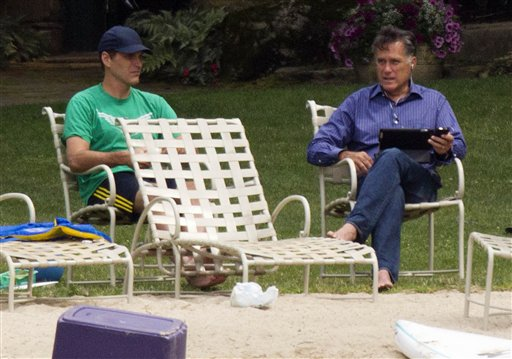 Republican presidential candidate, former Massachusetts Gov. Mitt Romney, right, laptop in hand, talks with his son Josh by Lake Winnipesaukee at his home in Wolfeboro, N.H., Saturday, July 14, 2012.  (AP Photo/Evan Vucci)