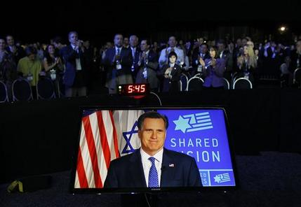 In this March 6, 2012, file photo, Republican presidential candidate, former Massachusetts Gov. Mitt Romney, is displayed on screen as he speaks before the American Israel Public Affairs Committee (AIPAC), via satellite in Washington. (AP Photo/Charles Dharapak, File)