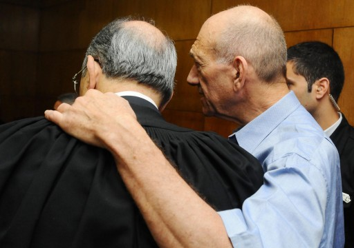 Former prime minister and Jerusalem mayor Ehud Olmert with his attorney at the Tel aviv distrcit court. The trial of former Prime Minister Ehud Olmert on his involvement in the Holyland Project affair Began today, Sunday 1 2012.