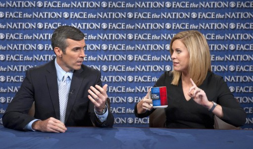 """In this July 15, 2012, photo released by CBS, Stephanie Cutter, right, who is serving as deputy campaign manager for President Barack Obama's 2012 re-election and Senior Advisor to the Romney Campaign Kevin Madden, left, talk on CBS's """"Face the Nation"""" in Washington. (AP Photo/CBS, Chris Usher"""