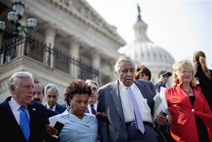From left, House Minority Whip Steny Hoyer of Md., Rep. Eliot Engel, D-N.Y., Rep. Barbara Lee, D-Calif., Rep. Charles Rangel, D-N.Y., Rep. Carolyn Maloney, D-N.Y., and others, walk down the steps of the House On Capitol Hill in Washington, Thursday, June 28, 2012, after walking off the floor in protest of a contempt of Congress vote for Attorney General Eric Holder. (AP Photo/David Goldman)
