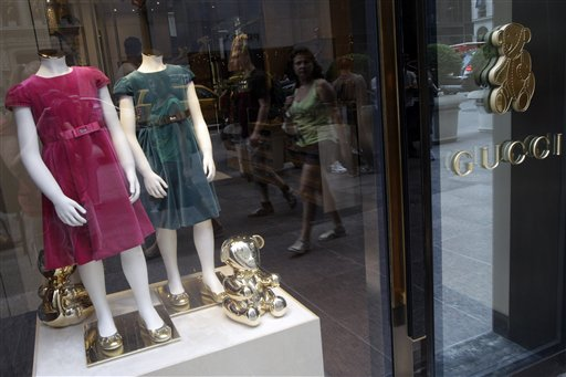 In this July 19, 2012 photo, girls dresses appear on display at the Gucci children's boutique on Fifth Avenue in New York. Gucci's two-level children's boutique on New York's Fifth Avenue, next door to its adult flagship, may have brass teddy bears on the walls and plush child-sized furniture, but the prices for the miniature looks are hardly child's play.  (AP Photo/Mary Altaffer)